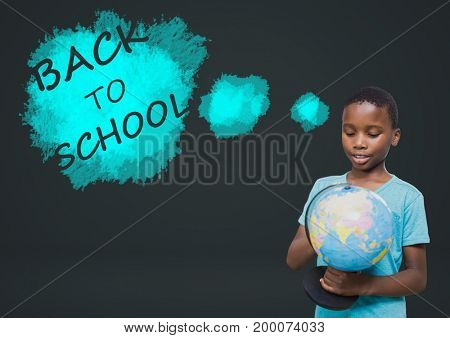 Digital composite of Back to school text and boy holding world globe