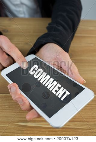Digital composite of Comment text and graphic on phone screen with hands