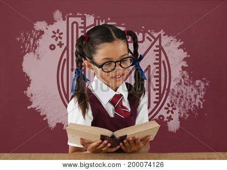 Digital composite of Student girl at table reading against red blackboard with education and school graphic