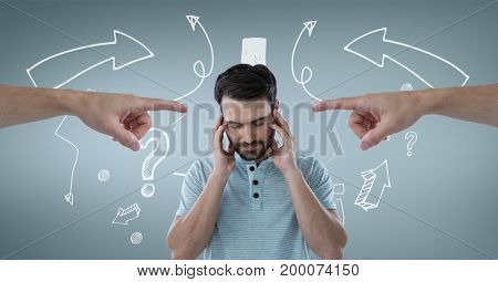 Digital composite of Hands pointing at sad man against blue background with arrows