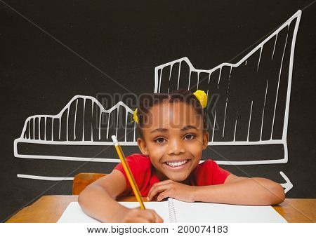 Digital composite of Student girl at table against grey blackboard with school and education graphic