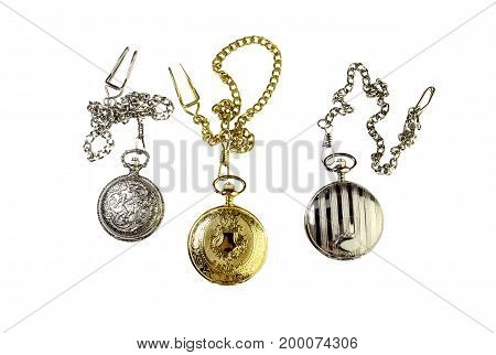 The three vintage pocket watch with a chain on a white background closeup