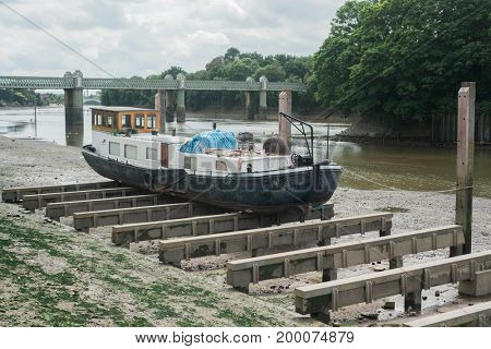 Old boat on dry dock in the River Thames in London