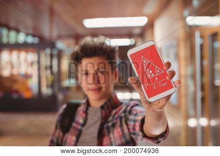 Digital composite of Boy holding a phone with school icons on screen