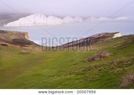 Stunning View Of White Cliffs On Coast With Rocks And Ocean
