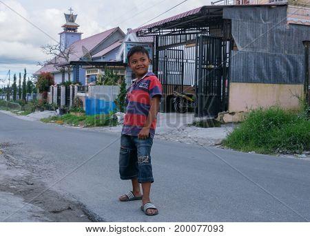 BERASTAGI INDONESIA 15 MAY 2017 : Indonesian boy posing on the street of Berastagi city Northern Sumatra.