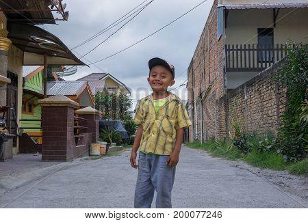 BERASTAGI INDONESIA 15 MAY 2017 : Indonesian boy on the street of Berastagi city Northern Sumatra.