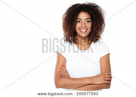 Picture of happy young african lady standing isolated over white background. Looking at camera.