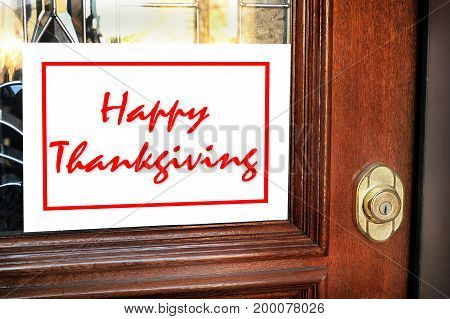 Happy Thanksgiving Sign on  the  front doorway.