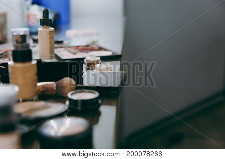 The professional cosmetics lies on the table in the beauty salon