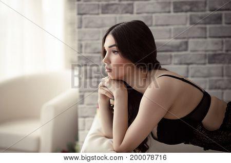 beautiful sensual woman in underwear thoughtful closeup