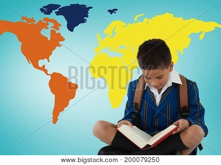 Digital composite of Schoolboy reading in front of colorful world map