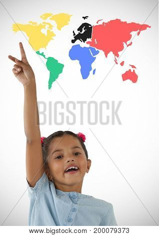 Digital composite of Girl reaching hand up in the air in front of colorful world map