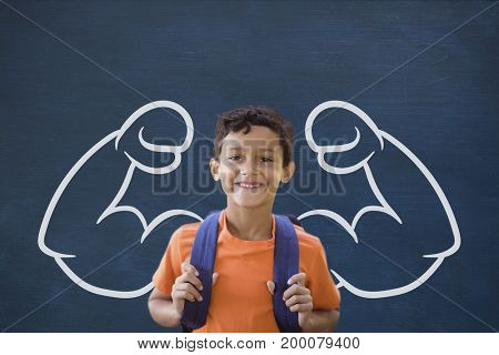 Digital composite of Happy student boy with fists graphic standing against blue blackboard