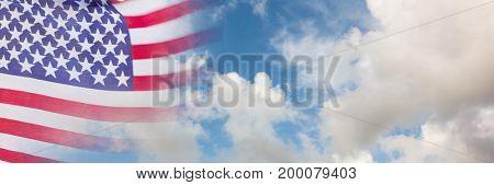 Digital composite of USA flag with sky transition