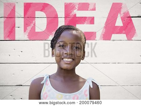 Digital composite of Idea text with girl in front of wall