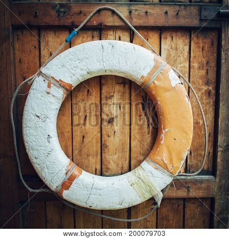 retro lifebuoy on wooden wall background close up