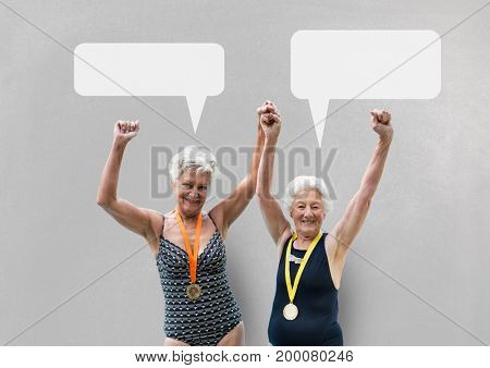 Digital composite of Excited elder women with speech bubbles against grey background