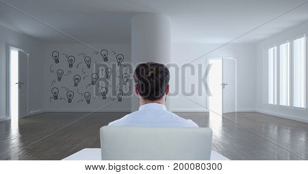 Digital composite of Business man sitting in a 3D room with a conceptual graphic on the wall