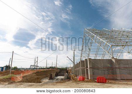 Building Under Construction Against A Blue Sky