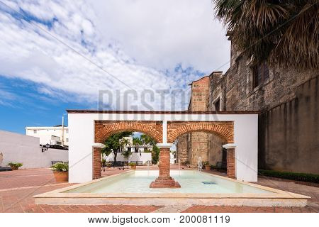 View of the arch and fountain Santo Domingo Dominican Republic. Copy space for text