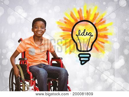 Digital composite of Disabled boy in wheelchair with idea light bulb