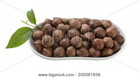 Heap of hazelnut in a white plate isolated on white background.