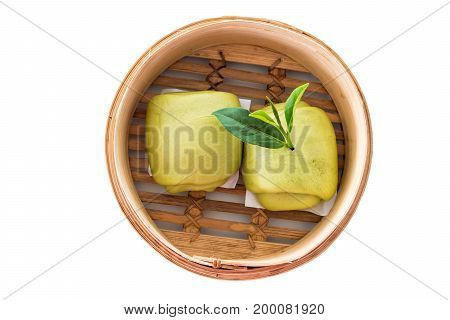 Steamed Bun And Green Tea Leaves Isolated On White Background. Clipping Path