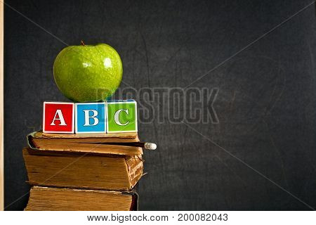 Abc And Green Apple On Old Textbook