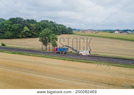 Aerial View On Working Asphalt Scrapping Machine