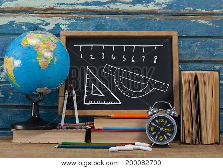 Digital composite of ruler measurement on blackboard