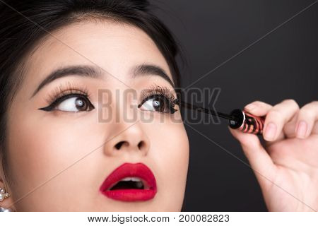 Make-up And Cosmetics Concept. Asian Woman Doing Her Makeup Eyelashes Black Mascara.