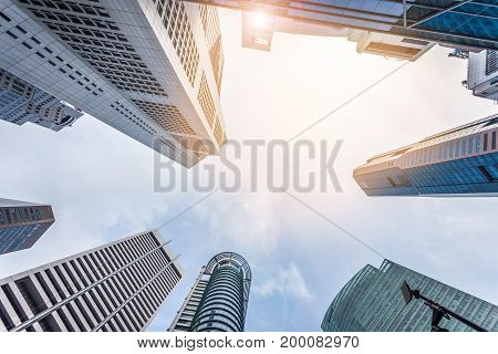 Abstract Modern Architecture Building On Blue Sky With Sunlight Background.