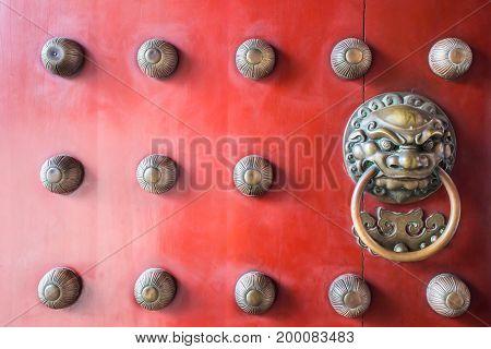Chinatown traditional red wooden door guardian brass handle