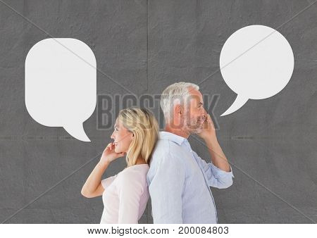 Digital composite of Couple with speech bubble talking on the phone against grey background
