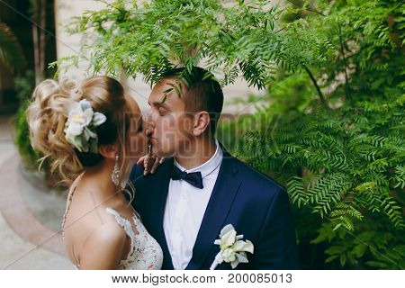 Groom And Bride On A Walk Outdoors