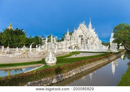 Wat Rong Khun The White Abstract Temple And Pond With Fish, In Chiang Rai, Thailand. Popular And Fam