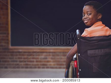 Digital composite of Disabled boy in wheelchair in school classroom