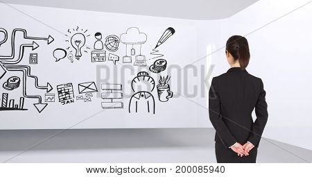 Digital composite of Business woman standing in a 3D room with a conceptual graphic on the wall