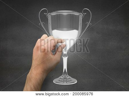 Digital composite of Person touching a trophy
