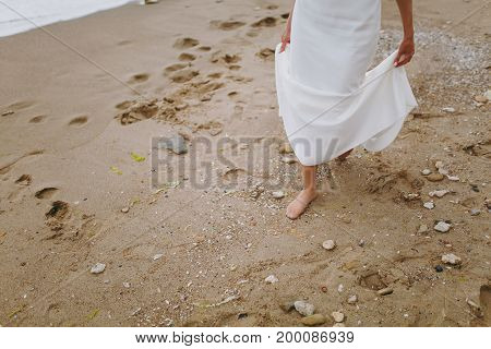 Feet Of The Bride On The Beach
