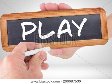 Digital composite of Hand writing play on blackboard with chalk