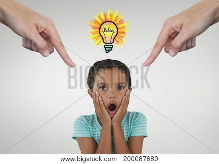 Digital composite of Hands pointing at surprised girl against white background with bulb icon