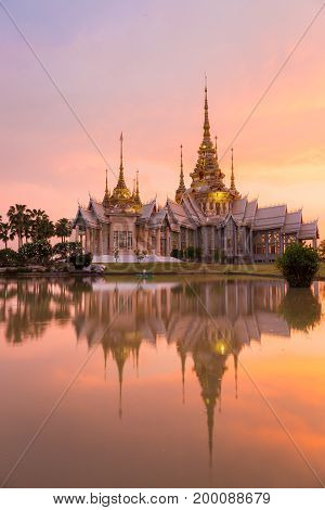 Landmark of wat thai with shadow reflection sunset in temple at Wat None Kum in Nakhon Ratchasima province Thailand