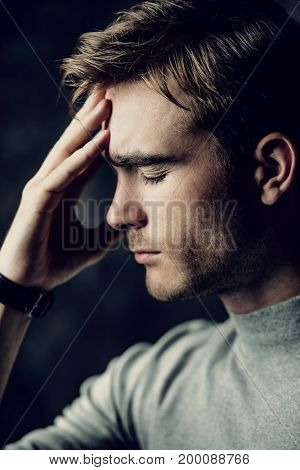 Portrait of a handsome man is thinking hard about something. The power of thought, brainstorming. Business concept.