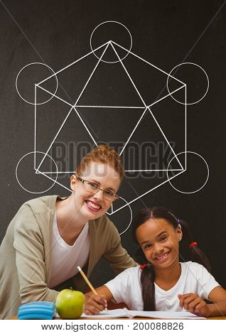 Digital composite of Happy student girl and teacher at table against grey blackboard with school and education graphic