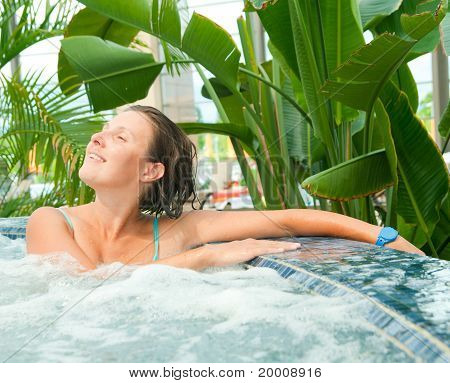 Attractive young woamn relaxing in a Jacuzzi