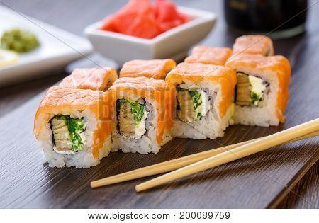 Philadelphia roll sushi with salmon, prawn, avocado, cream cheese. Sushi menu. Japanese food