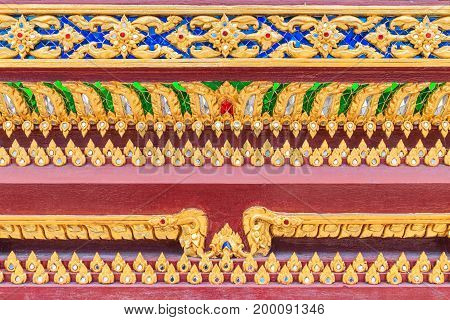 Close up pattern of Lai Thai on the base Thai Buddhist church in Bangkok Thailand.