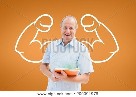 Digital composite of Happy student man with fists graphic standing against orange background